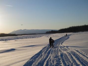 Pushing the bike through soft snow.